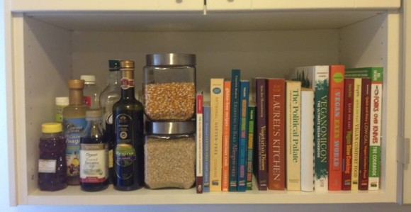 shelf with canisters of gluten-free grains and cookbooks displayed