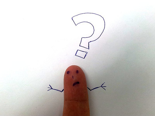 "Image of thumb making ""I don't know"" face with question mark"
