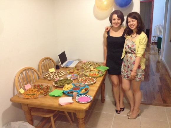 The proud hosts with the full spread (minus desserts; I'll tell you about those soon)