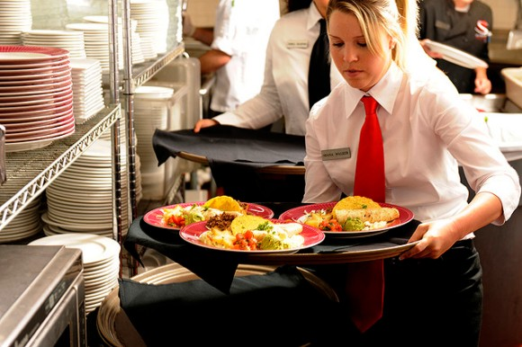 waitress with tray of tacos