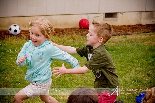 boy chasing girl in duck, duck, goose game