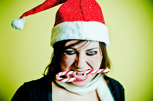 angry Santa girl with candy cane