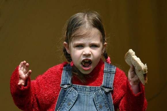 girl eating bread and yelling