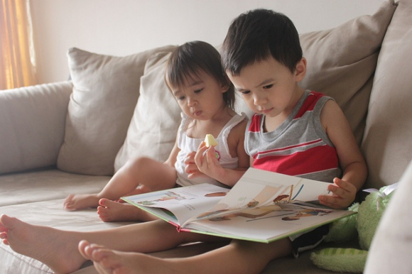 And here are some cute kids reading the real thing and wondering why the mouse is so demanding. Photo © Matthew Hauck | Flickr