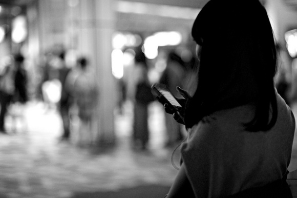 girl on iPhone black and white