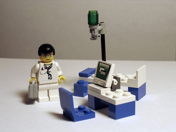 Lego doctor with laptop